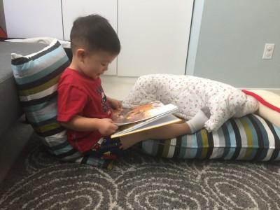 ezra reading sitting